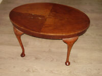 Wooden oval coffee table with ball feet