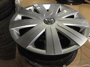 "ON SALE OEM Dealer Take offs OEM VW 15""Steel with hub caps"