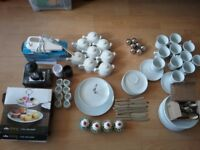 Selection of white tea room crockery, cake stands, cafetiere, decorative suger bowls etc