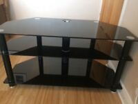 """Black glass TV stand for up to 49""""."""