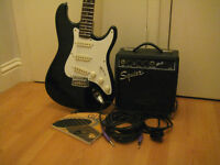 Black Stratocaster electric guitar and Fender Squier amplifier package
