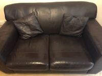 Brown faux leather two seater sofa
