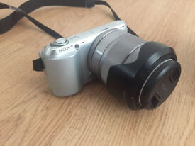Sony NEX C3 with 18-55 lens, flash, charger and spare batteries