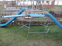 Climbing frame with two slides and ladder bridge