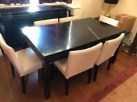 Black wooden Dining table and 7 chairs - has extending piece to seat 8