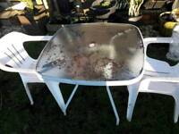 Metal garden table and 2 plastic chairs