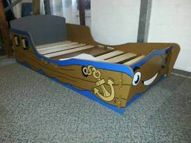 A brand new slight seconds pirate toddler bed frame.