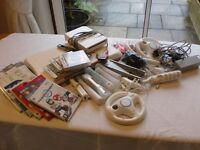 Nintendo Wii Game with lots of accessories, balance board, wheel, motion plus. Plus several DVD
