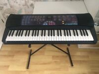 Casio Keyboard: Light Up Keys (Stand included)