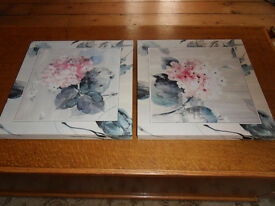 two canvas floral type pictures, heavy, not cheap ones 16 x 16 ins. were £40.
