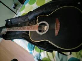 Steel string acoustic electric guitar