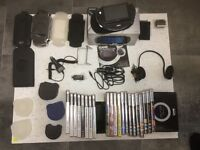 PlayStation Portable (PSP) with games, films, and accessories