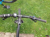 Carerra xc mountain bike. Brand new back wheel just fitted