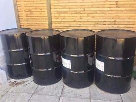 4 black oil drums