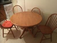Good quality solid wood dining table and 4 chairs