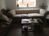 Large Chesterfield sofa. Four seater. Oatmeal colour. Linen/hessian style fabric. Very comfortable.