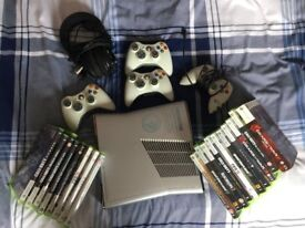 Limited edition xbox 360 halo reach console plus 4 controllers, 20 games and a turle beach headset