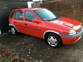 Red Vauxhall Corsa