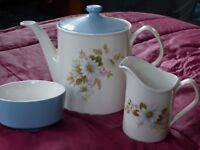 Porcelain Tea pot, sugar and cream.