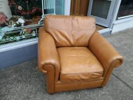 Tan leather armchair offers