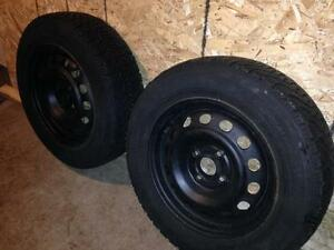 two Goodyear Nordic 185/65-14 winter tires with rims