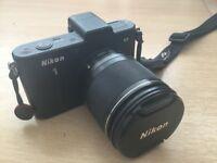 Nikon 1 V1 with 10 - 100 zoom lens, flash gun & charger.