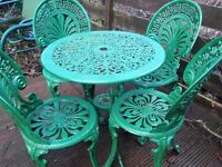 light metal table plus 4 chairs in metal green color