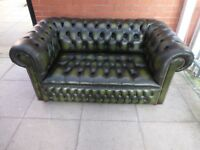 A Dark Green Leather Chesterfield Buttoned Sofa