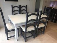 Lovely solid wood painted dining table and 6 cushioned chairs