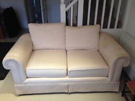 Two-seater cream sofa