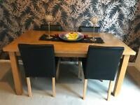 Solid wood dining table and 4 black chairs