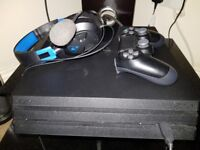 Playstation 4 pro with headset,2 controllers and games boxed