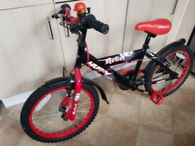 "Huffy Rebel kids bike 11""frame 18""wheels.20£"