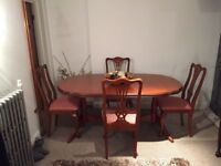 Mahogany extendable dining table and 4 chairs in good condition, collection only