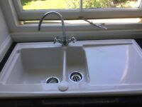 White porcelain one and half bowl kitchen sink plus tap.