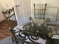 Glass table and four lovely chairs great kitchen / Dining room set