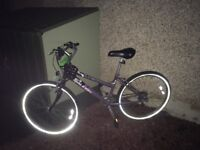Raleigh female bicycle with lights and chain