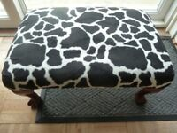 Mahogany cow print footstool with beautiful legs and bear claws feet