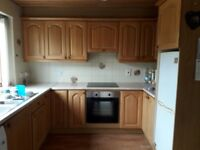 Kitchen with Solid Light Oak cupboard doors includes oven, hob and sink. Available now