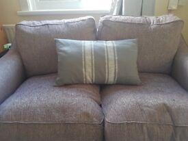 Grey cushion with white stripes