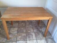 PineSolutions 4ft Rectangular Oak Dining Table which seats 4 and is in good condition for sale