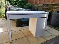 white Micke Desk 105 × 50cm and white ikea shelves