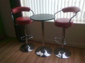 2 x RED LEATHER STOOLS AND TABLE