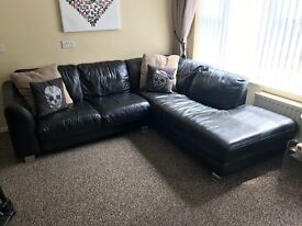 Black leather corner sofa and matching chair