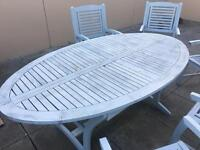 Heavy wooded out door dining table and chairs