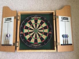 Unicorn dart board with cabinet