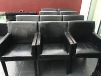 Free. 10 x Scruffy Black Faux leather chairs