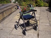 4/WHEELED ROLLATOR IN VERY GOOD CLEAN CONDITION .