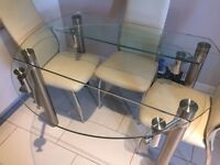 Glass dining table with side extensions