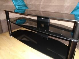 BLACK GLASS TV UNIT IN EXCELLENT CONDITION